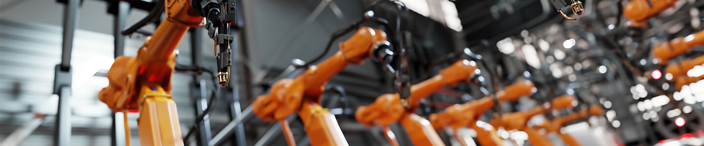 Robotic arms demonstrating automation in a plant environment